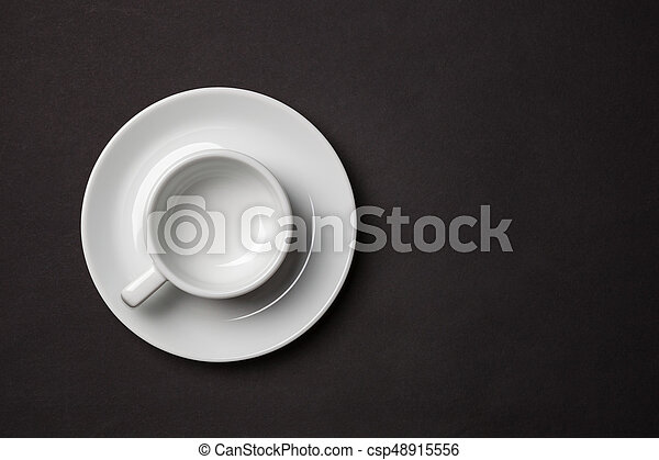 Empty white cup for espresso with saucer on black background. - csp48915556