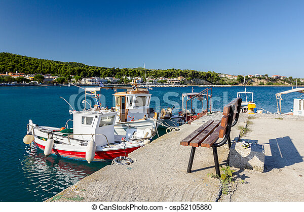 Outstanding Empty Wooden Bench At Boat Dock With Beautiful Docked Fishing Boats Evergreenethics Interior Chair Design Evergreenethicsorg