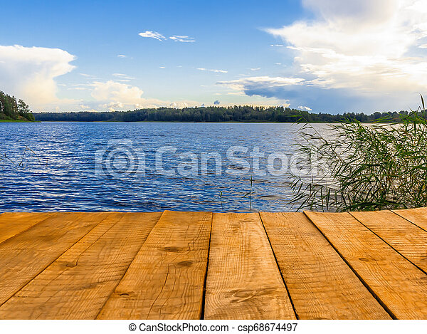 Empty wooden pier for swimming, boats or fishing on the lake - csp68674497