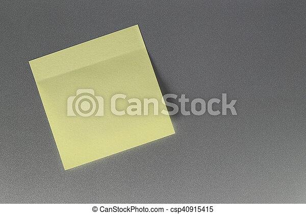 Empty yellow paper sheet on refrigerator door for design. - csp40915415