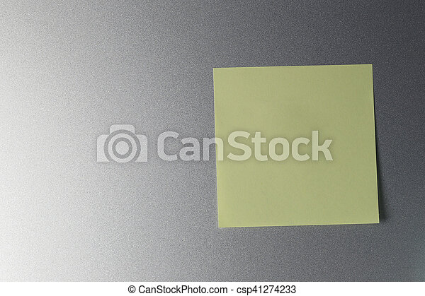 Empty yellow paper sheet on refrigerator door for design. - csp41274233