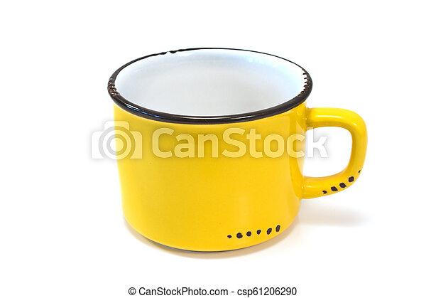 Enamel yellow mug isolated on white - csp61206290