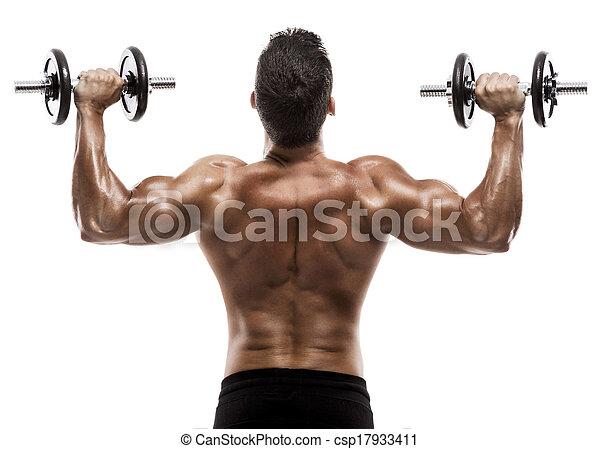 Hombre musculoso en el estudio levantando pesas, aislado sobre un fondo blanco - csp17933411