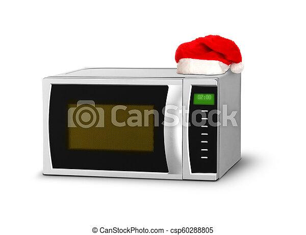 El microondas navideño sobre el blanco - csp60288805