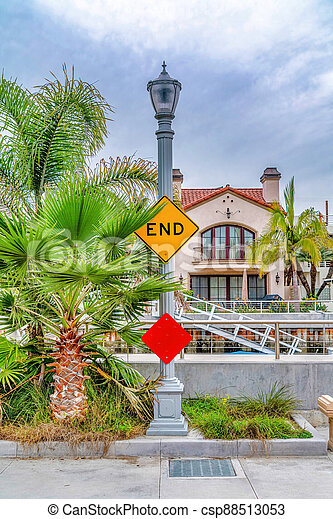 End sign and blank red sign on a lamp post in Long Beach California neighborhood - csp88513053