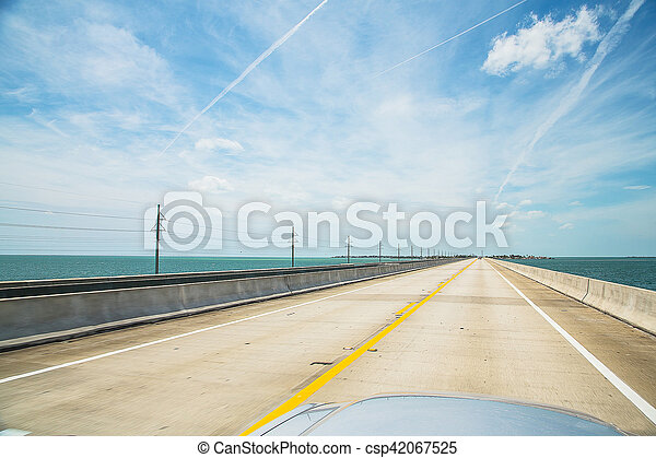 Endless empty road by the ocean in a great car. Endless road. Atlantic intracoastal and highway us1. Florida Keys interstate. - csp42067525