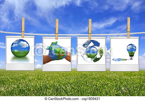 Grüne Energielösungsbilder hängen an einem Seil - csp1809431