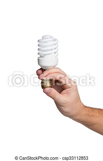 Energy saving lamp in male hand - csp33112853