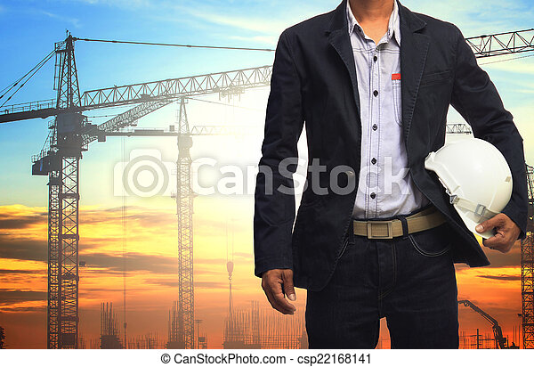 engineer man working with white safety helmet against crane and  - csp22168141