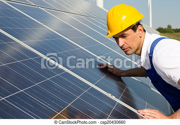 Engineer or installer inspecting solar energy panels - csp20430660