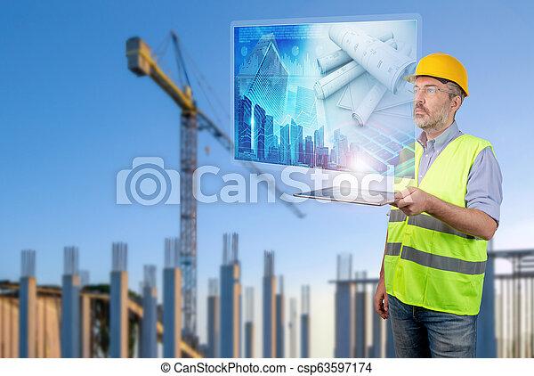 engineer working with buildings digital plan - csp63597174