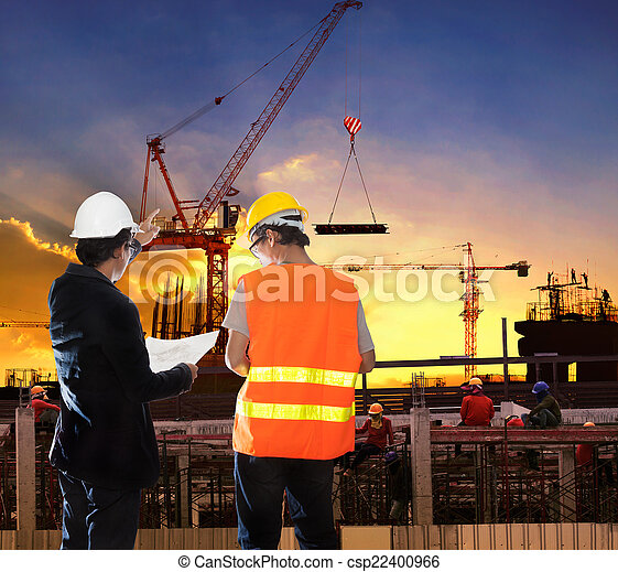 engineering man working in building construction site with worke - csp22400966