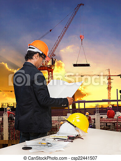 engineering man working in building construction site against be - csp22441507