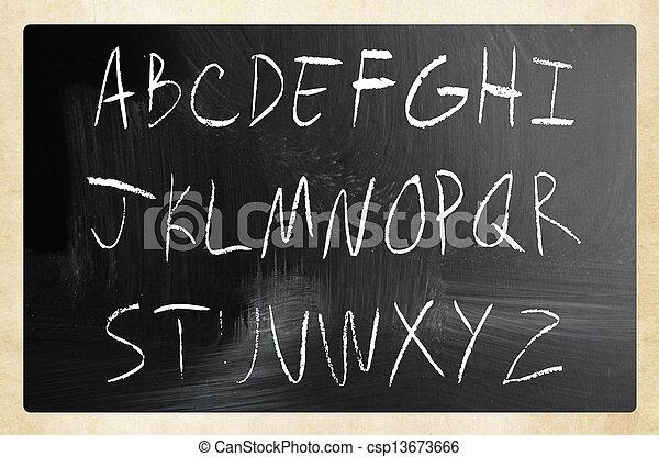 English alphabet handwritten with white chalk on a blackboard - csp13673666