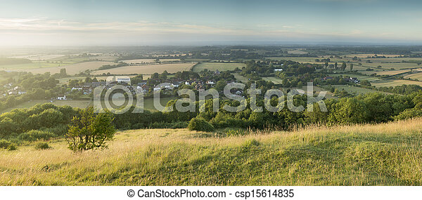 English countryside landscape during late Summer afternoon with dramatic sky and lighting - csp15614835