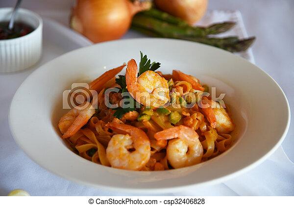 Enjoyable shrimp pasta with tomato - csp32406828