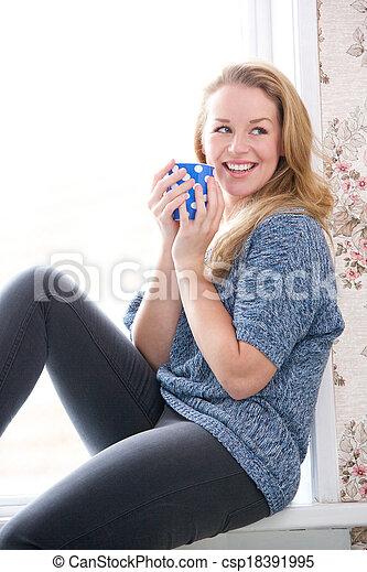 Enjoying a cup of tea at home - csp18391995