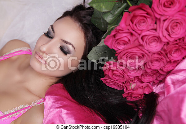 Enjoyment. Treatment. Beauty Model Woman Face. Beautiful Girl With Roses Flowers. Perfect Skin. Professional Make-up.  - csp16335104