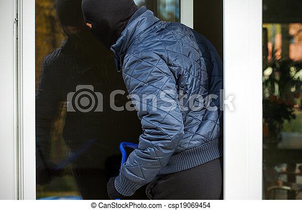 Entering though window - csp19069454