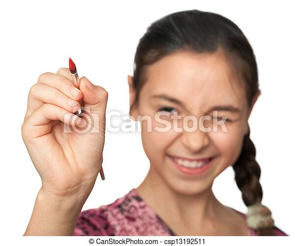 La chica con lentejuelas dibuja un pincel en el espacio - csp13192511