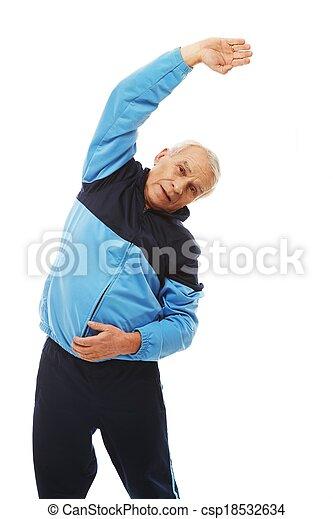 Un hombre con traje de entrenamiento haciendo ejercicios de estiramiento - csp18532634