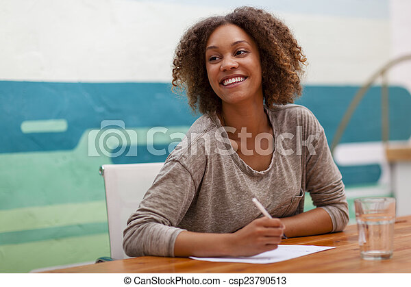 Entrepreneur smiling at an office table - csp23790513