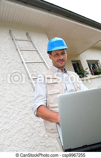 Entrepreneur using laptop computer - csp9967255