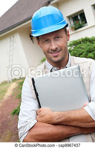 Entrepreneur with security helmet on - csp9967437