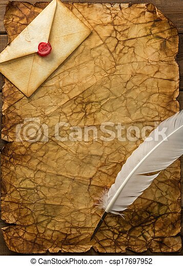 Envelope and quill pen on vintage paper over wooden ...