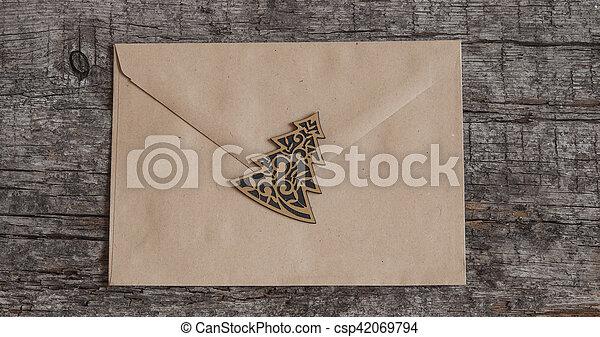 envelope on wooden background - csp42069794