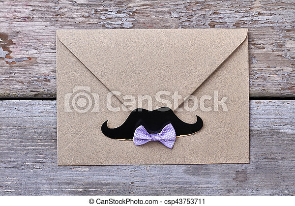 Envelope with mustache on wood. - csp43753711