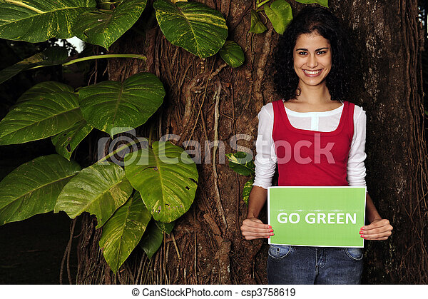 environment conservation: woman in the forest holding a go green sign - csp3758619