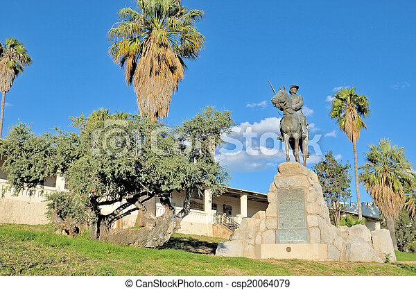 Equestrian rider monument and Alte Feste in Windhoek - csp20064079
