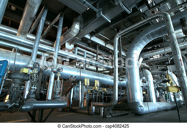 Equipment, cables and piping as found inside of a modern industrial power plant                    - csp4082425