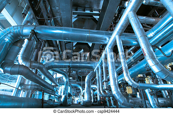 Equipment, cables and piping as found inside of a modern industrial power plant - csp9424444