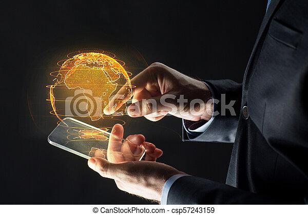 erde, smartphone, hologramm, hände - csp57243159