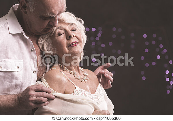 https://comps.canstockphoto.com/erotic-picture-of-senior-couple-stock-image_csp41065366.jpg