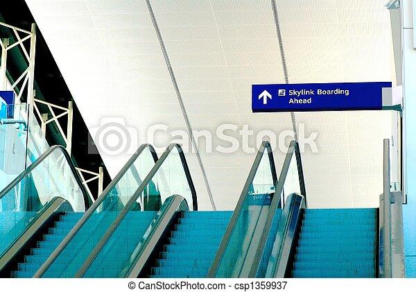 escalator in an airport - csp1359937