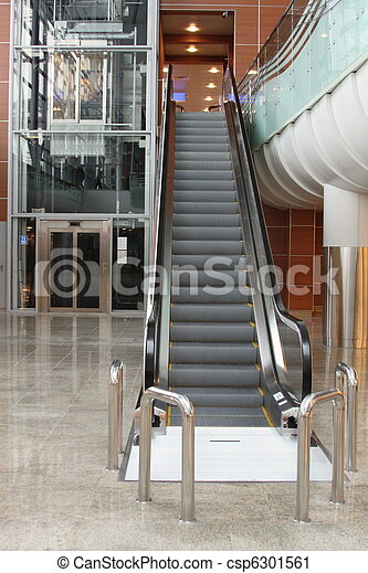 Escalator with elevator at the airport - csp6301561