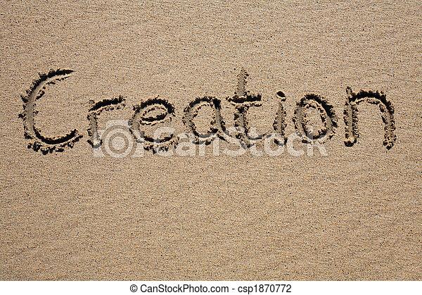 Creación, escrita en una playa de arena. - csp1870772