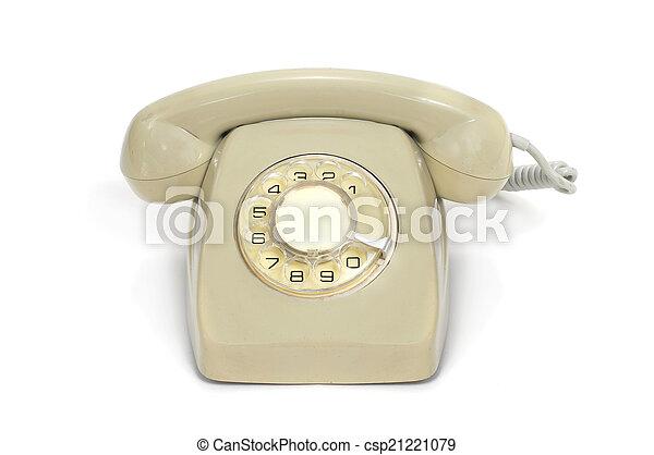 Un viejo teléfono de marcación rotaria - csp21221079