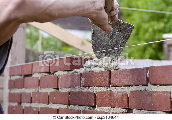 espalhar, trowel, cimento, tijolos - csp3104644