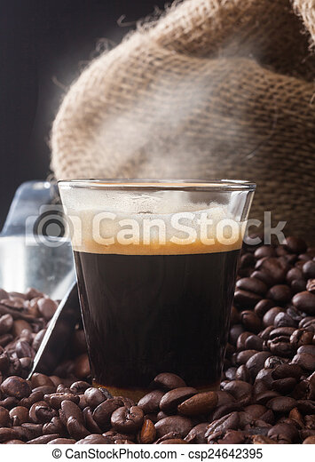 Espresso coffee in glass cup with coffee beans. - csp24642395