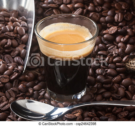 Espresso coffee in glass cup with coffee beans. - csp24642398