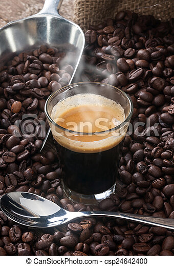Espresso coffee in glass cup with coffee beans. - csp24642400