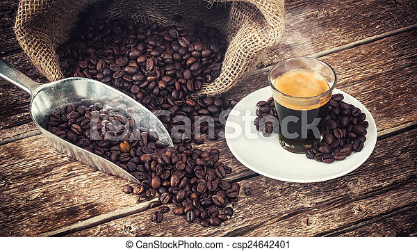 Espresso coffee in glass cup with coffee beans. - csp24642401