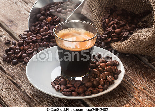 Espresso coffee in glass cup with coffee beans. - csp24642402