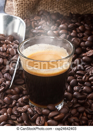Espresso coffee in glass cup with coffee beans. - csp24642403