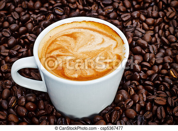 espresso cup in coffee beans - csp5367477
