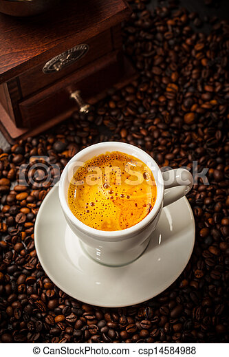 Espresso cup in coffee beans - csp14584988